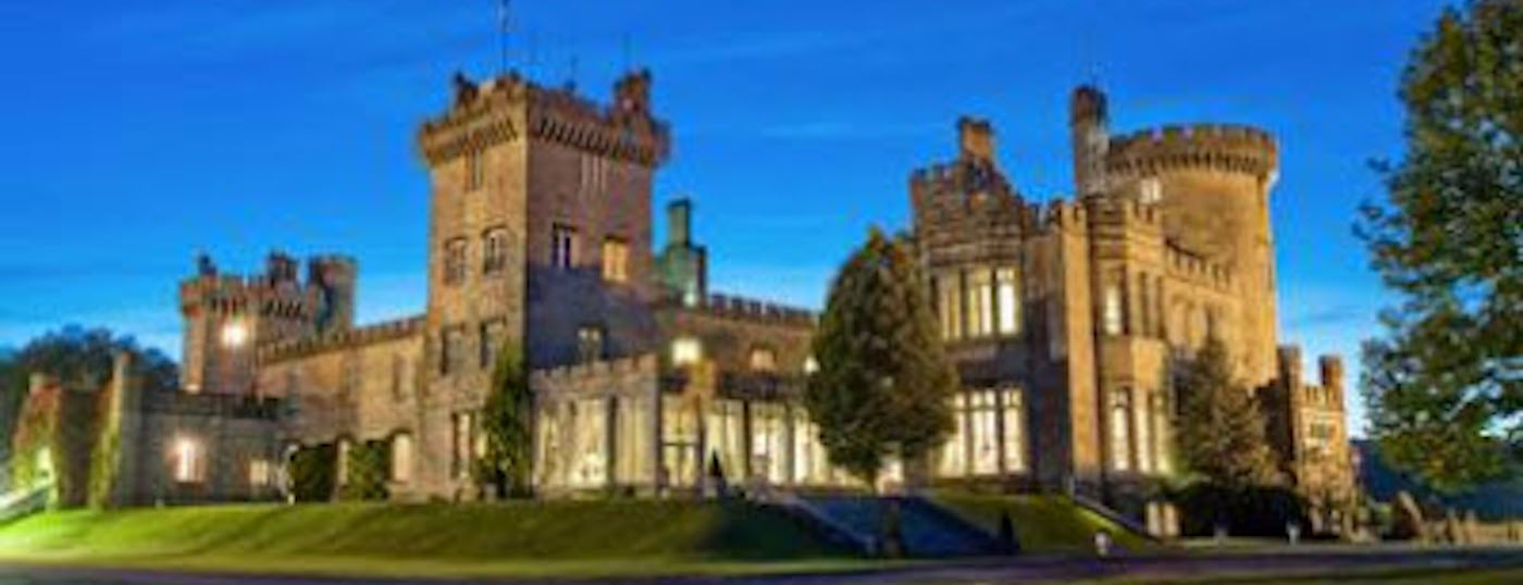 On an ExecutiveTours Holiday you could stay here, in the Dromoland Castle (view of hotel building at evening)