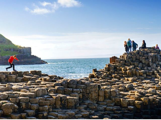 People standing on the Giant's Causeway | Family Tours Ireland
